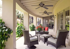 outdoor ceiling fan helps cool a solid patio cover