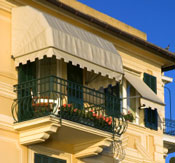 fabric awnings shade a balcony and small window