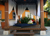a shaded cabana with drawn curtains